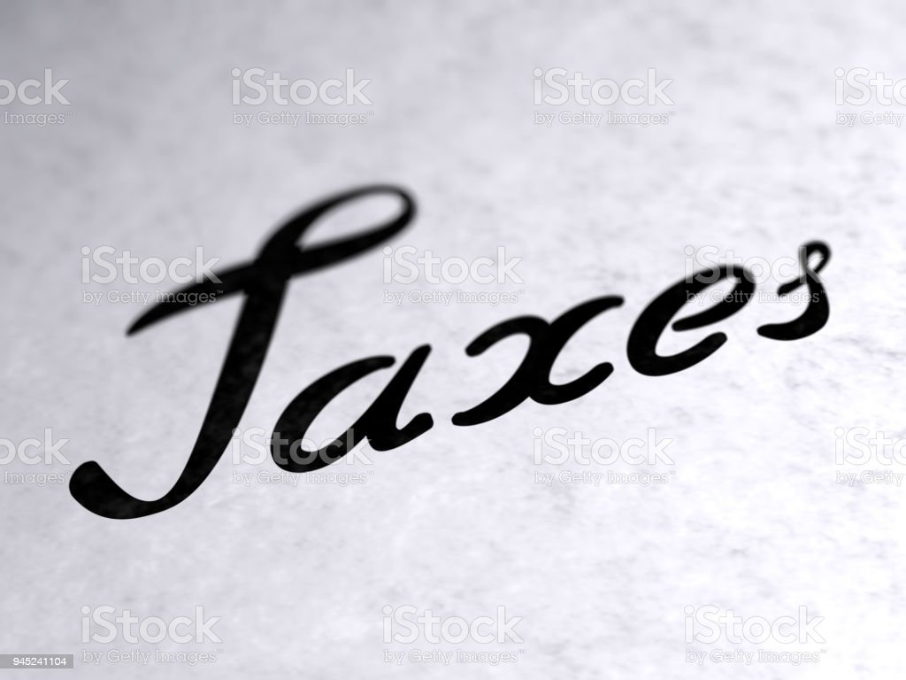 'Taxes' on the page. stock photo