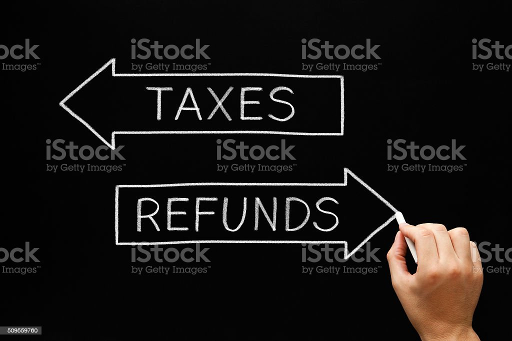 Taxes Refunds Arrows Concept Blackboard stock photo
