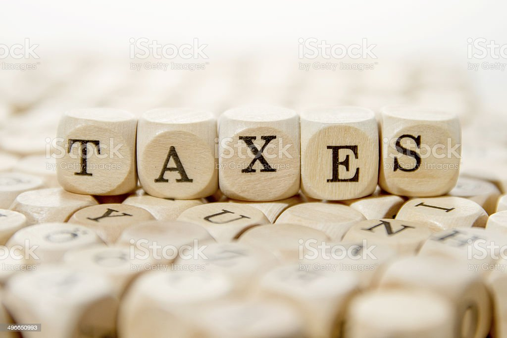Taxes word stock photo