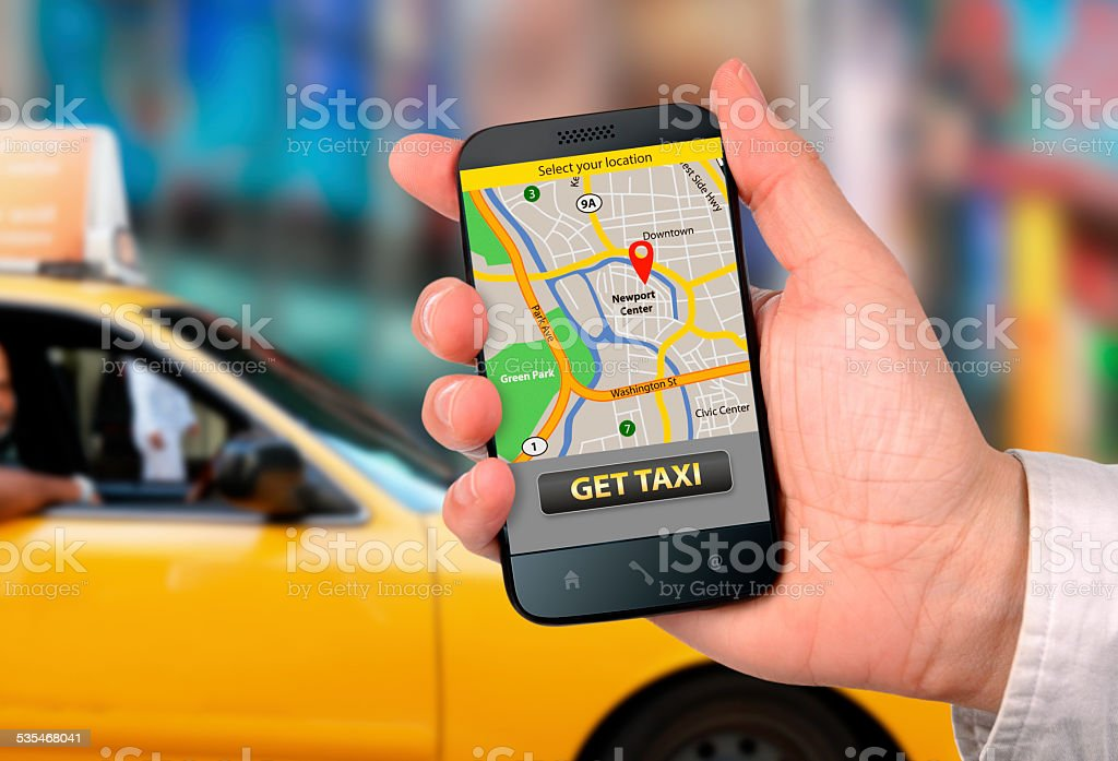 Taxi application on smart phone in action stock photo
