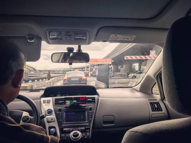 Taxi arriving in Roissy Charles de Gaulles Airport in Paris, France Paris, France - May 14, 2017: Taxi arriving in Roissy Charles de Gaulles airport in Paris, view from inside of taxi val d'oise stock pictures, royalty-free photos & images