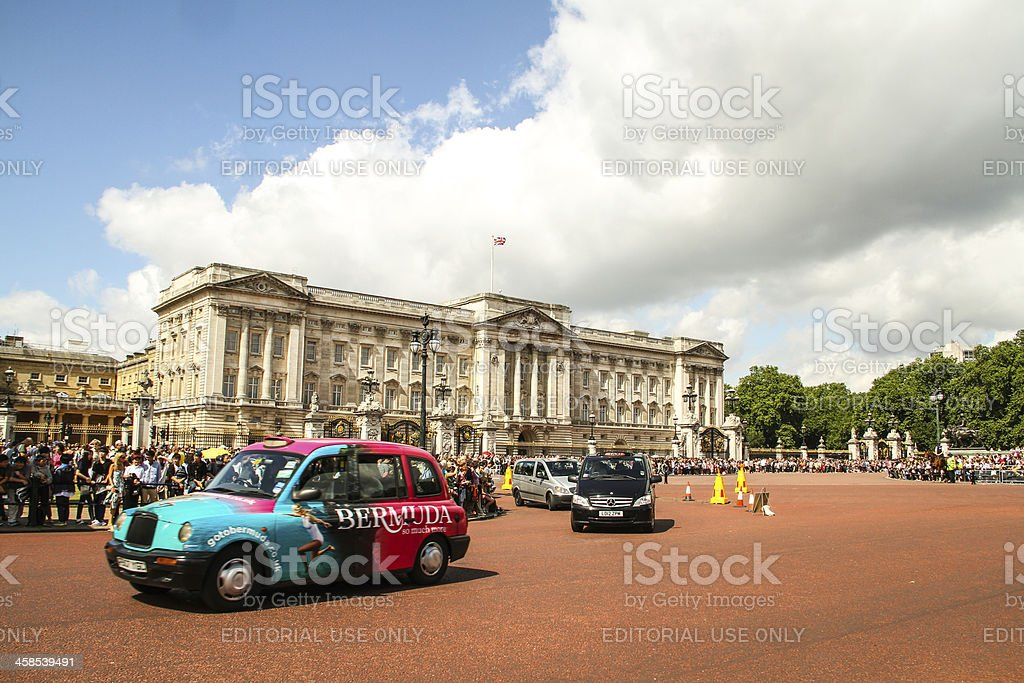 Taxi at Buckingham Palace, London. stock photo