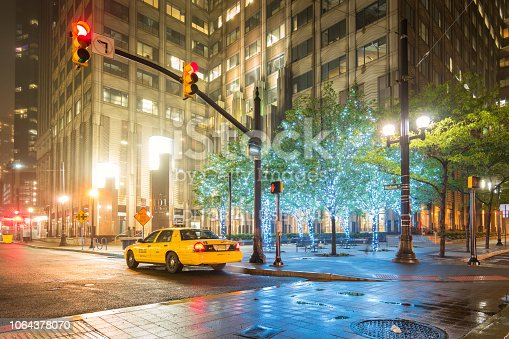 Taxi waits for customers at Exchange Place in Jersey City, New Jersey, USA in the evening.