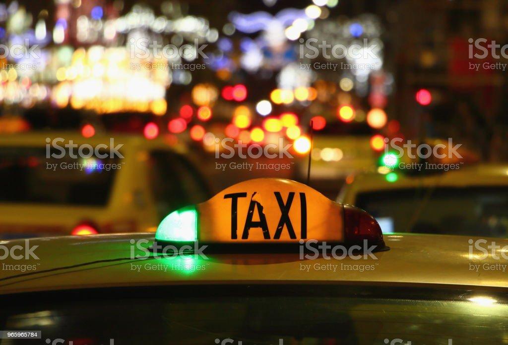 Taxi at night - Bucharest, Romania. - Стоковые фото Автомобиль роялти-фри