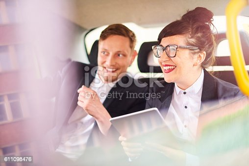 istock taxi business couple 611098476