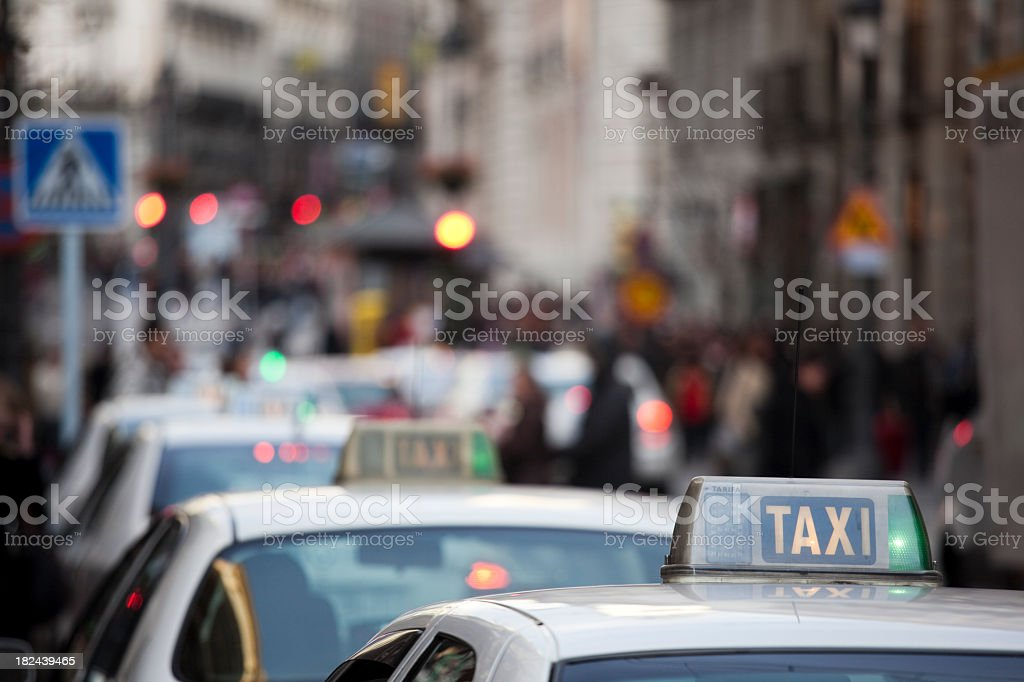 Taxi Cabs in traffic at Puerta del Sol, Madrid Spain stock photo