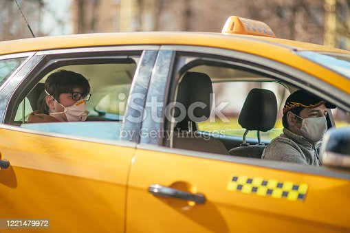 Yellow taxi on a city street