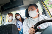 istock Taxi driver transporting passengers and wearing a facemask 1223488539