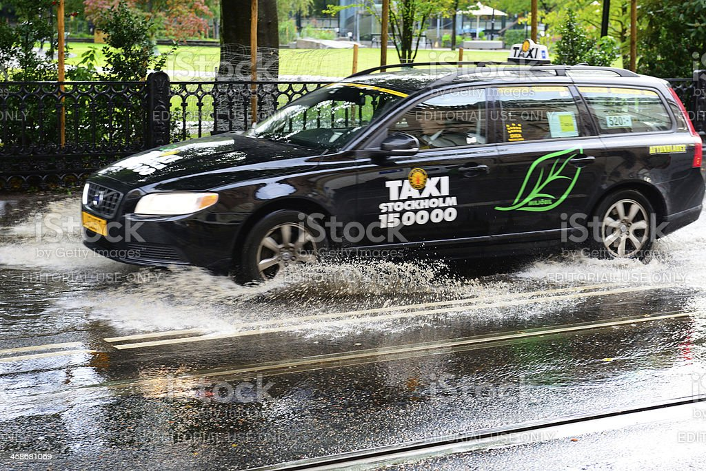 Taxi driving through deep puddle royalty-free stock photo