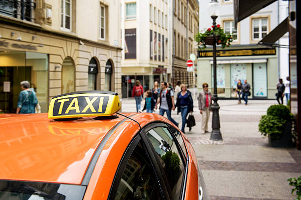 taxi europe luxembourg waiting for clients on shopping street - trainer bayern stock-fotos und bilder