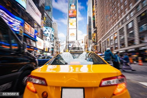istock Taxi goes fast in Times Square, New York 532858918
