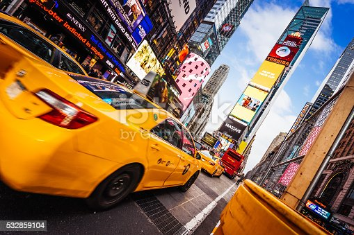 istock Taxi goes fast in Times Square, New York 532859104