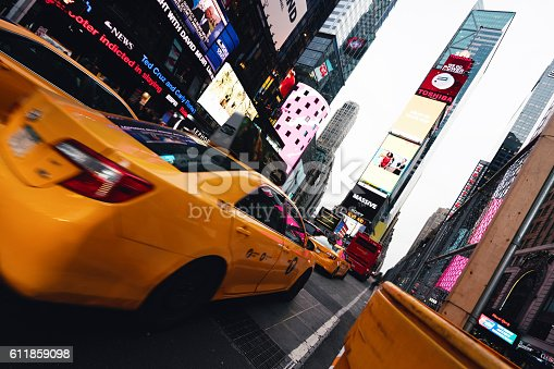 istock Taxi goes fast in Times Square, New York 611859098