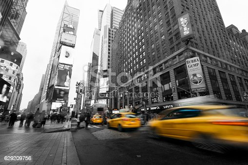 istock Taxi going fast in Times Square, New York 629209756