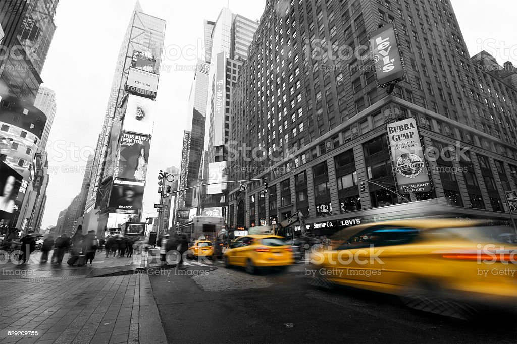 Taxi going fast in Times Square, New York stock photo