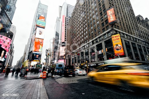 istock Taxi going fast in Times Square, New York 629210862