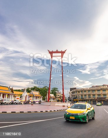 A Taxi green yellow on street at the Giant swing or Sao Ching Cha the  landmark of bangkok city. Thailand: 03/07/2019