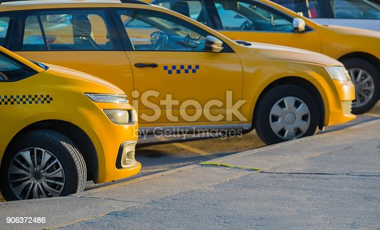 1087080996 istock photo taxi in the parking lot 906372486
