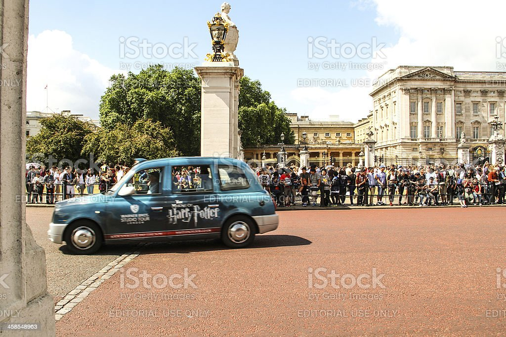 Taxi leaving Buckingham Palace stock photo