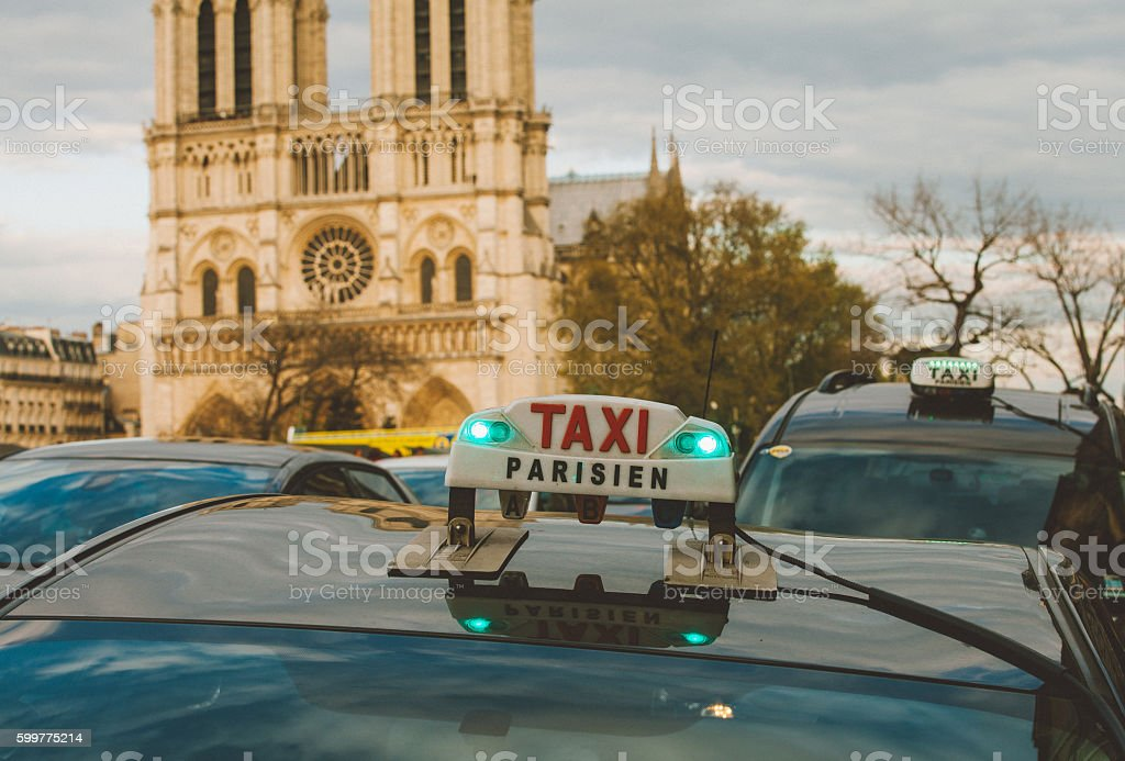 Taxi Parisien sign against Notre Dame in Paris stock photo