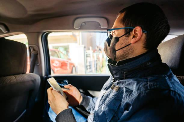 Taxi ride in time of Coronavirus stock photo