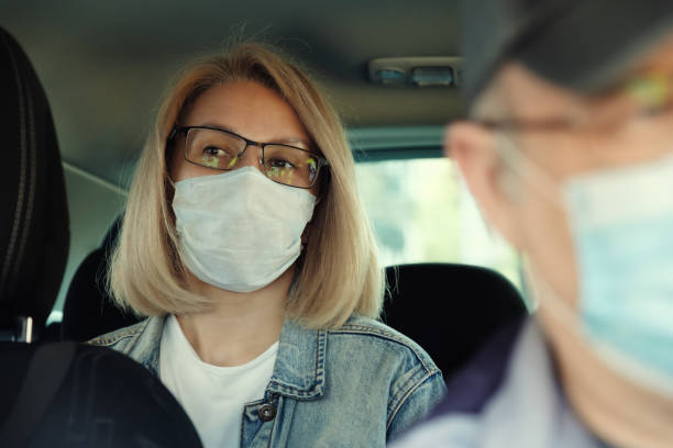 Taxi ride in time of Coronavirus stock photo