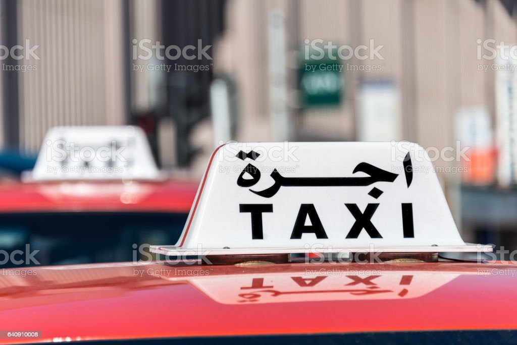Taxi sign in English and Arabic stock photo