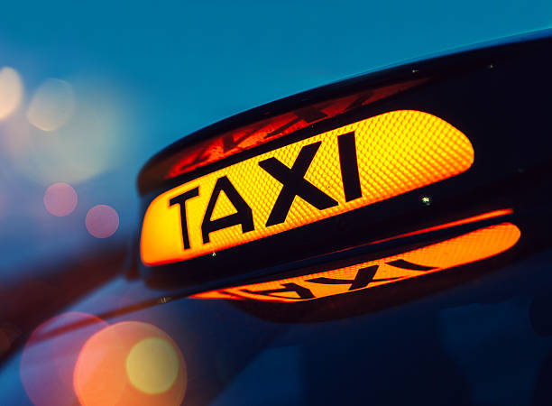 Taxi sign in London, UK stock photo