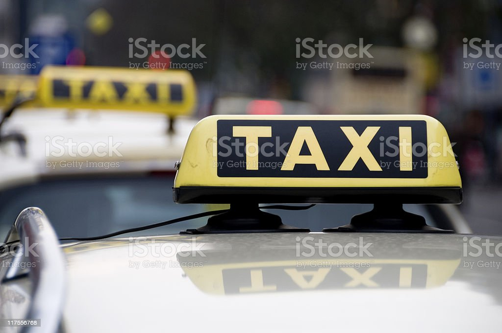 Taxi sign on car in the city royalty-free stock photo
