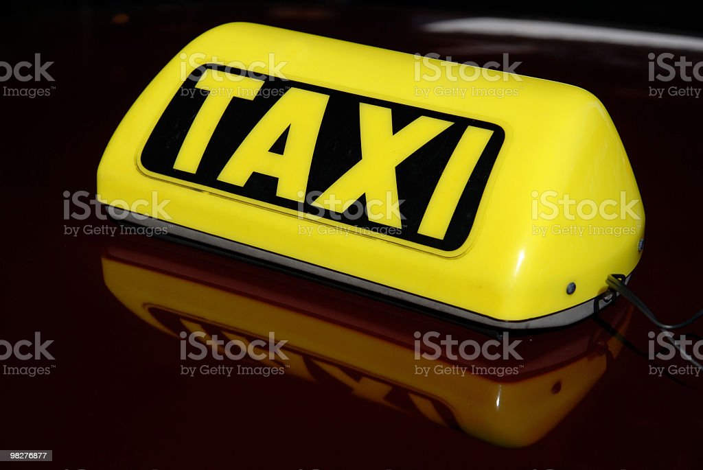 Taxi sign on car roof royalty-free stock photo