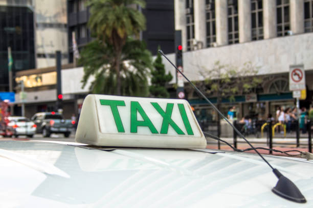 Taxi sign on roof of vehicle in Sao Paulo city stock photo
