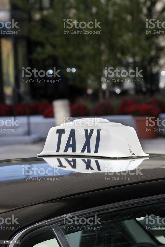 Taxi sign wcurbside background - vertical royalty-free stock photo