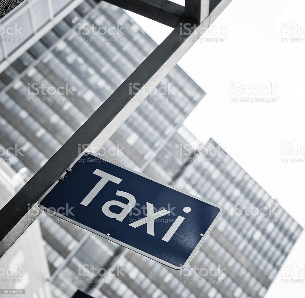 taxi sign with oslo skyscraper in background royalty-free stock photo