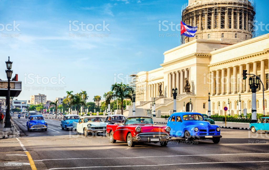 taxi vintage cars in front of capitolio in Havana. Cuba Vintage cars at rush hour in the morning in front of capitolio in La Habana. Cuba 2018 Stock Photo