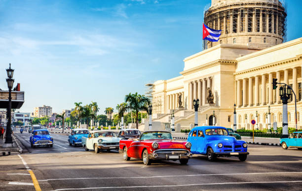 taxi vintage cars in front of capitolio in havana. cuba - cuba stock photos and pictures