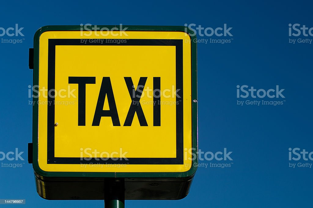 Taxicab stand neon sign royalty-free stock photo