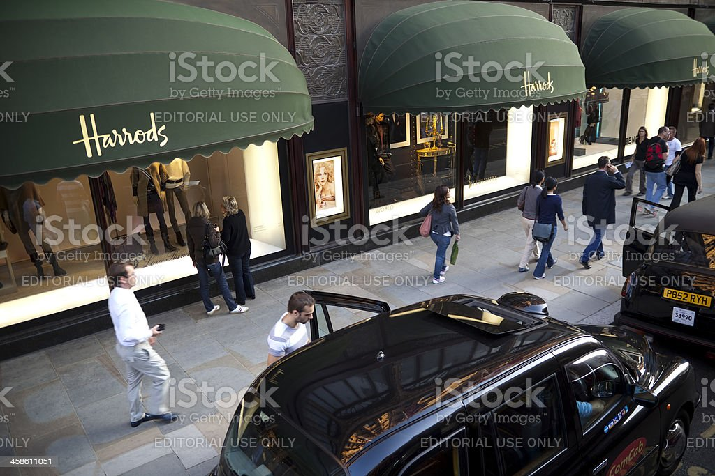 Taxis and Pedestrians in Front of Harrods Department Store, London stock photo