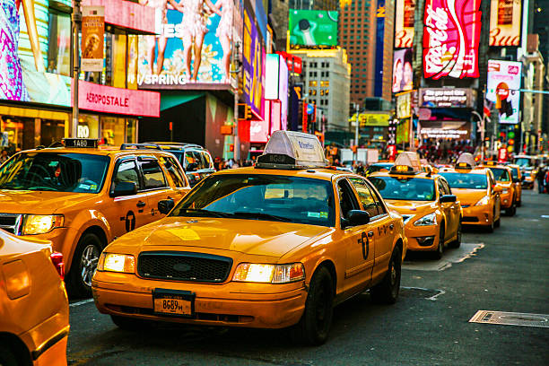 Taxis on 7th Avenue at Times Square, New York City Times Square, New York City, New York State, Night, Taxi new york state stock pictures, royalty-free photos & images