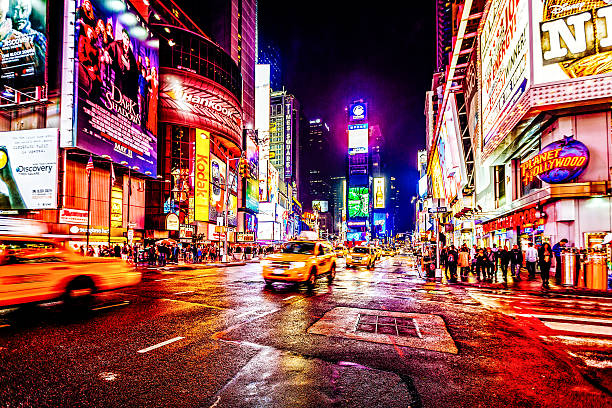 taxis on 7th avenue at times square, new york city - times square stock photos and pictures