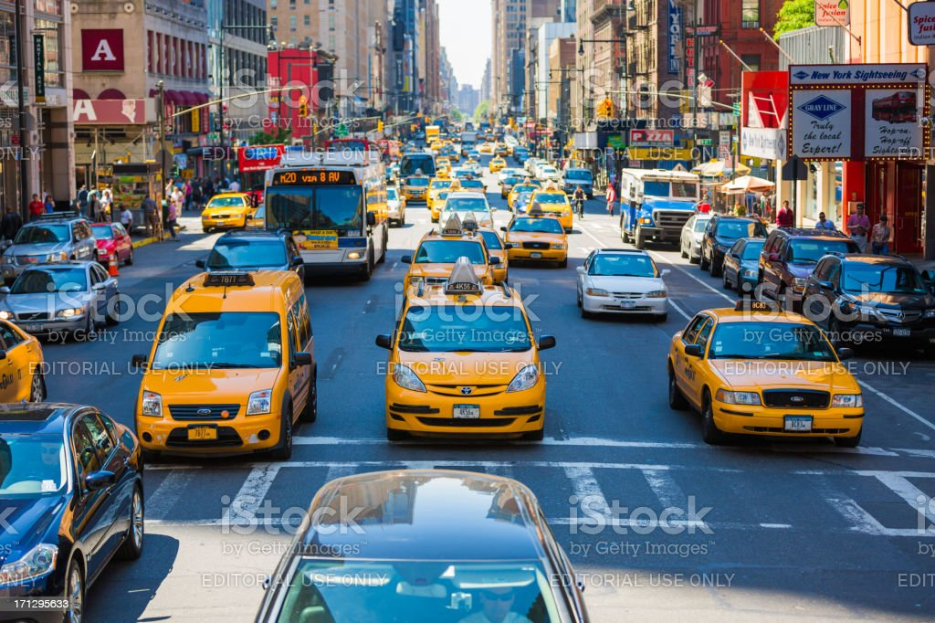 Taxis on 8th Avenue, New York City royalty-free stock photo