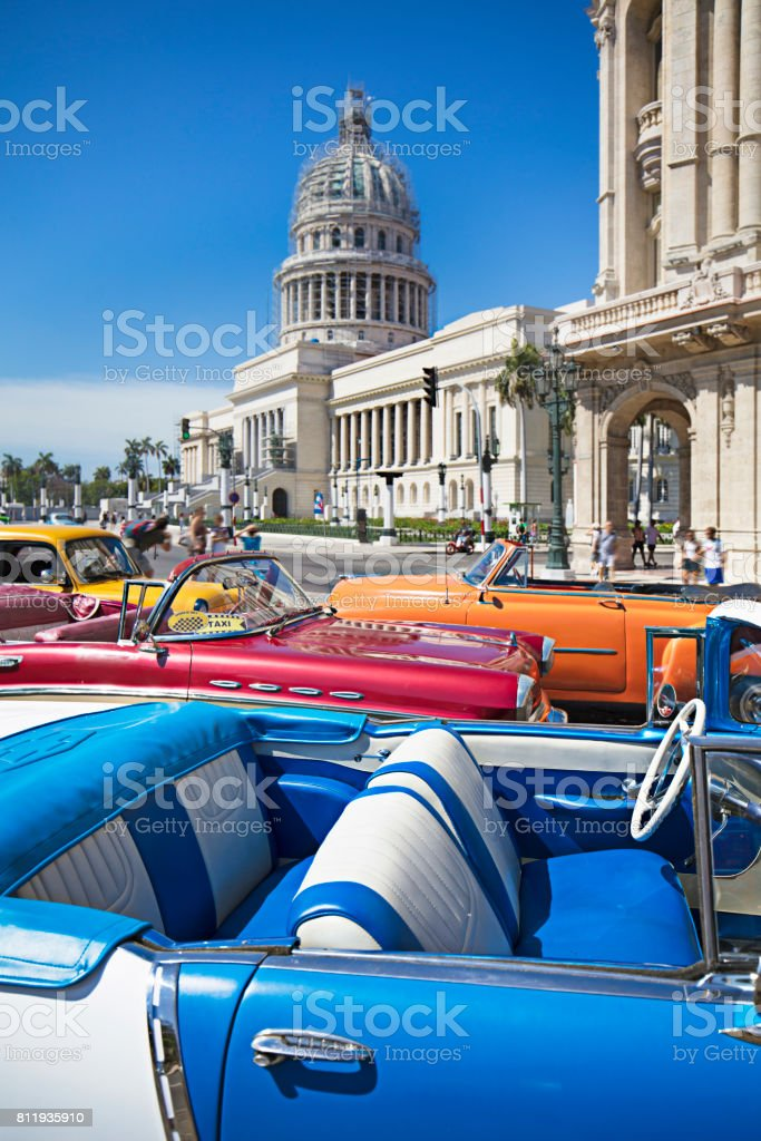 Taxis parked against Capitolio building in Havana stock photo