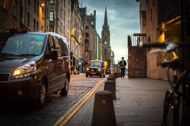 Taxis transport tourists along The Royal Mile in Edinburgh, Scotland stock photo
