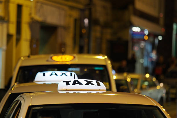 Taxis waiting in a Taxi Rank at Night stock photo
