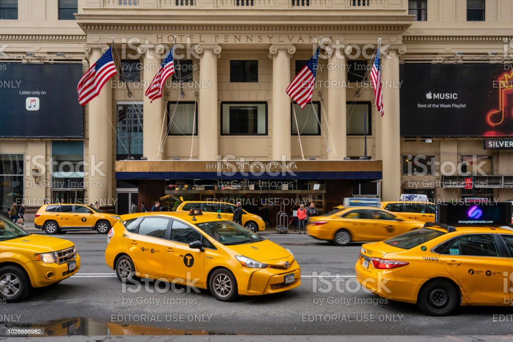 Taxis waiting outside a luxury hotel in New York City stock photo