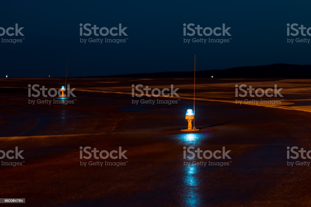 Taxiway, side row lights at the night airport стоковое фото