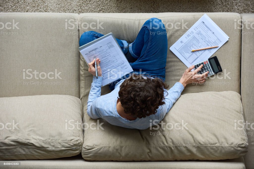 Tax-preparation at home stock photo