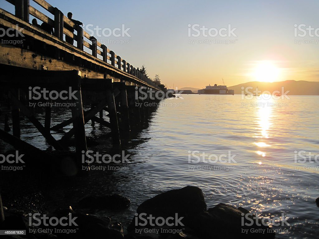 Taylor Dock Fading Toward Sunset over Lummi Island stock photo