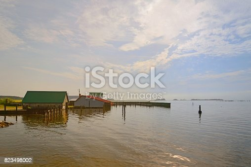 Boat houses at Taylors Landing on Chincoteague Bay along Maryland's Eastern Shore attest to the economic impact of the fishing industry for the Delmarva Peninsula