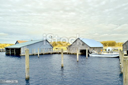 The boathouses at taylors landing are empty since the harvest of local seafood items hasn't started this spring