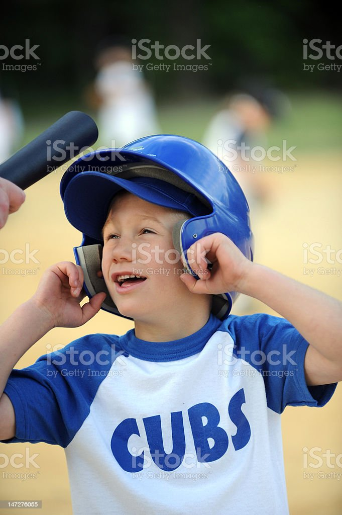 T-ball player getting instruction from coach stock photo